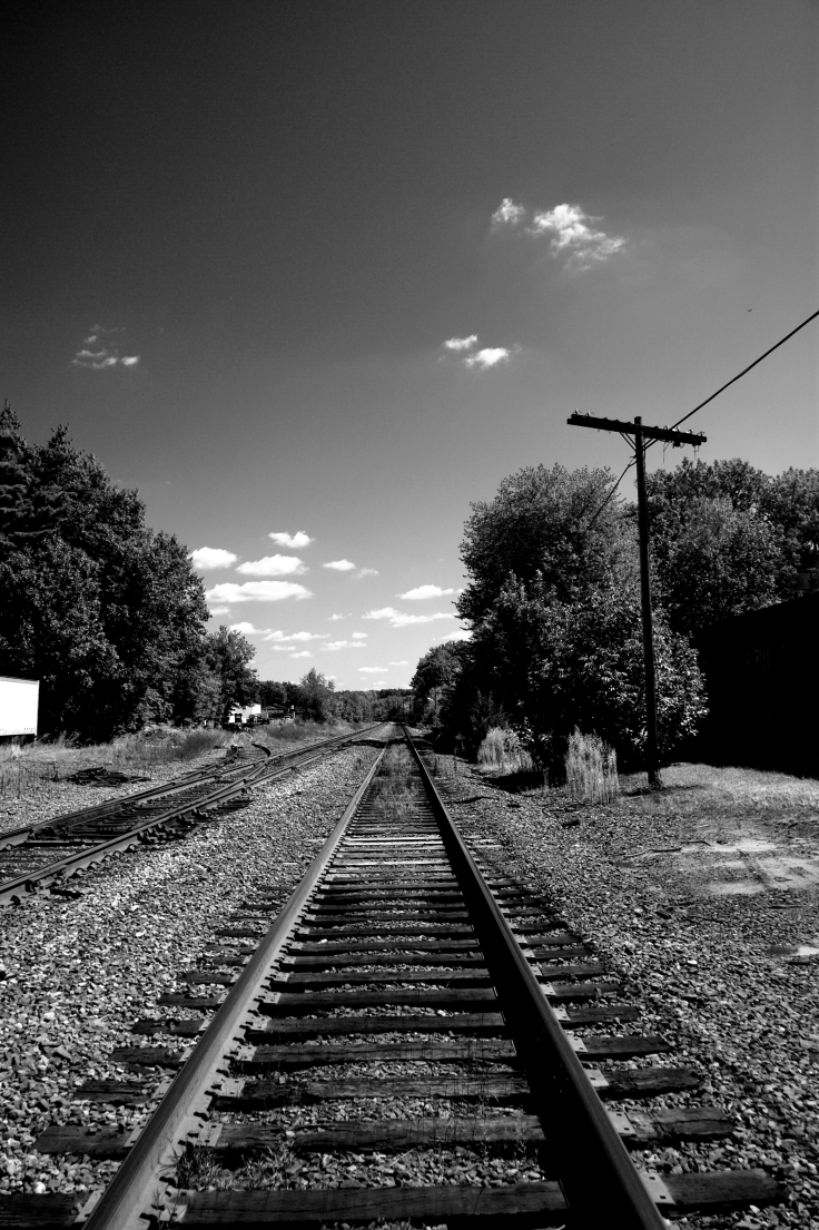 Fall 2009 - Groton RR tracks and clouds to horizon B&W