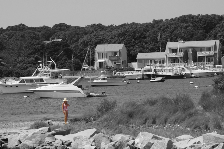 Summer 2009 - Martha's Vineyard woman on cell phone in swimsuit and hat cropped and b&w